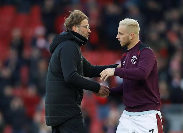 """Soccer Football - Premier League - Liverpool vs West Ham United - Anfield, Liverpool, Britain - February 24, 2018 Liverpool manager Juergen Klopp and West Ham United's Marko Arnautovic after the match Action Images via Reuters/Carl Recine EDITORIAL USE ONLY. No use with unauthorized audio, video, data, fixture lists, club/league logos or """"live"""" services. Online in-match use limited to 75 images, no video emulation. No use in betting, games or single club/league/player publications. Please contact your account representative for further details."""