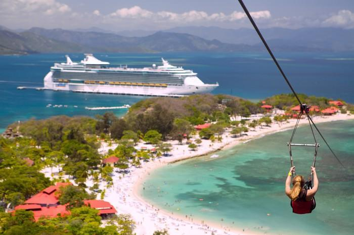 A guest zip-lining in Labadee at an RCL port-of-call.