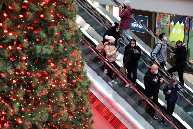 FILE PHOTO: Shoppers wearing mandatory masks pass Christmas Tree at Eaton Centre mall in downtown Toronto