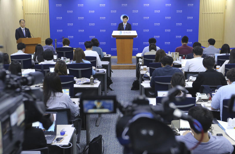 Bank of Korea Gov. Lee Ju-yeol, top center, speaks during a press conference in Seoul, South Korea, Thursday, July 18, 2019. South Korea's central bank on Thursday cut its policy rate for the first time in three years to combat a faltering economy that faces further risks from a heated trade dispute with Japan. (AP Photo/Ahn Young-joon)