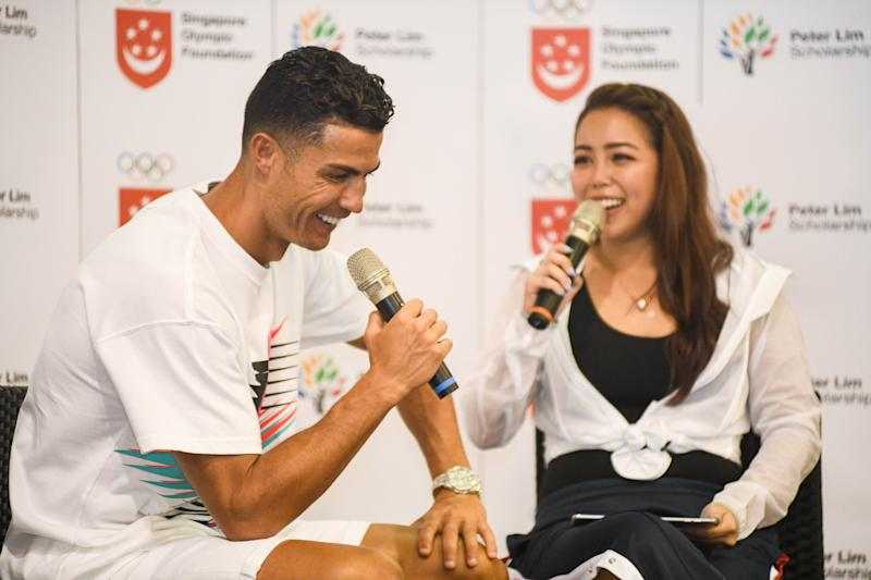 Football superstar Cristiano Ronaldo chats with the event host of his visit to the Yumin Primary School. (PHOTO: Stefanus Ian/Yahoo News Singapore)