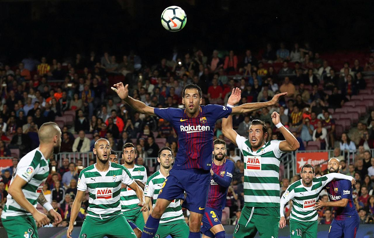Soccer Football - Santander La Liga - FC Barcelona vs Eibar - Camp Nou, Barcelona, Spain - September 19, 2017   Barcelona's Sergio Busquets in action with Eibar's Sergi Enrich    REUTERS/Albert Gea     TPX IMAGES OF THE DAY
