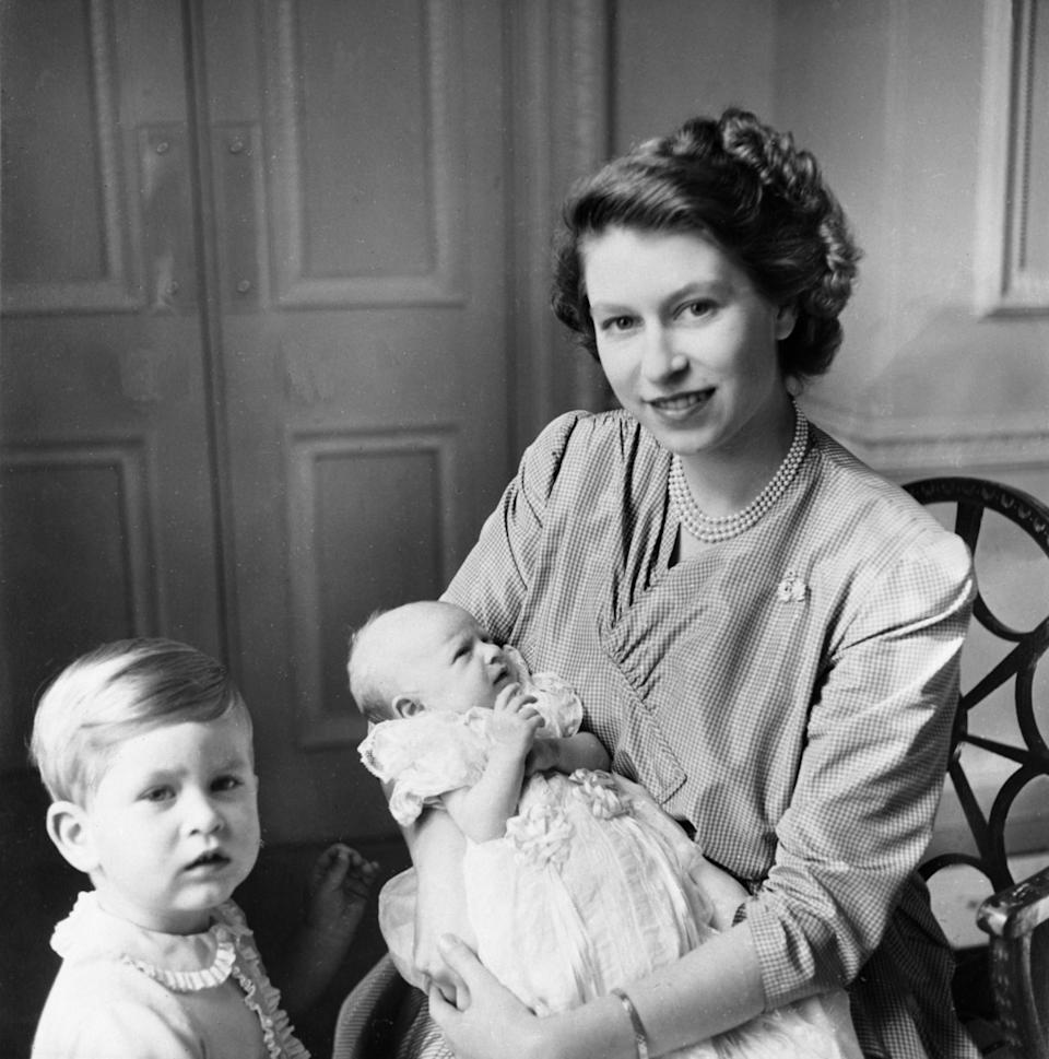 <p>Princess Elizabeth with her two children, Princess Anne and Prince Charles (PA Archive) </p>