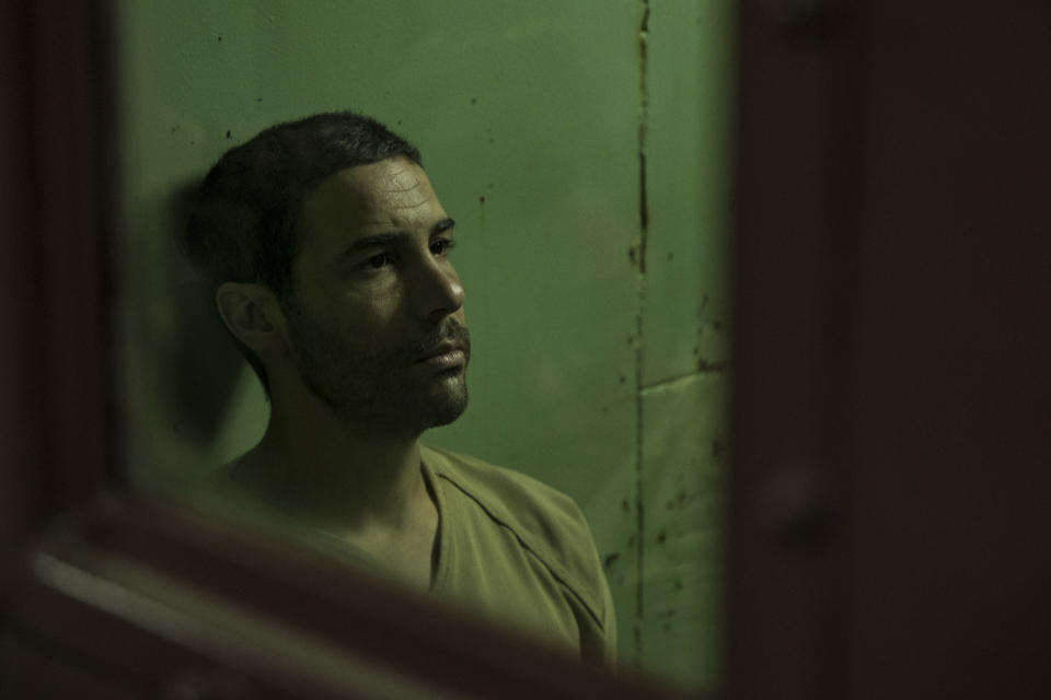 """This image released by STXfilms shows Tahar Rahim in """"The Mauritanian."""" Rahim was nominated for a Golden Globe for for best actor in a motion picture drama. (Graham Bartholomew/STXfilms via AP)"""