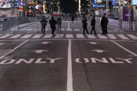 Seventh Avenue is mostly empty during what would normally be a Times Square packed with people in New York, late Thursday, Dec. 31, 2020, as celebrations have been truncated this New Year's Eve due to the ongoing pandemic. (AP Photo/Craig Ruttle)