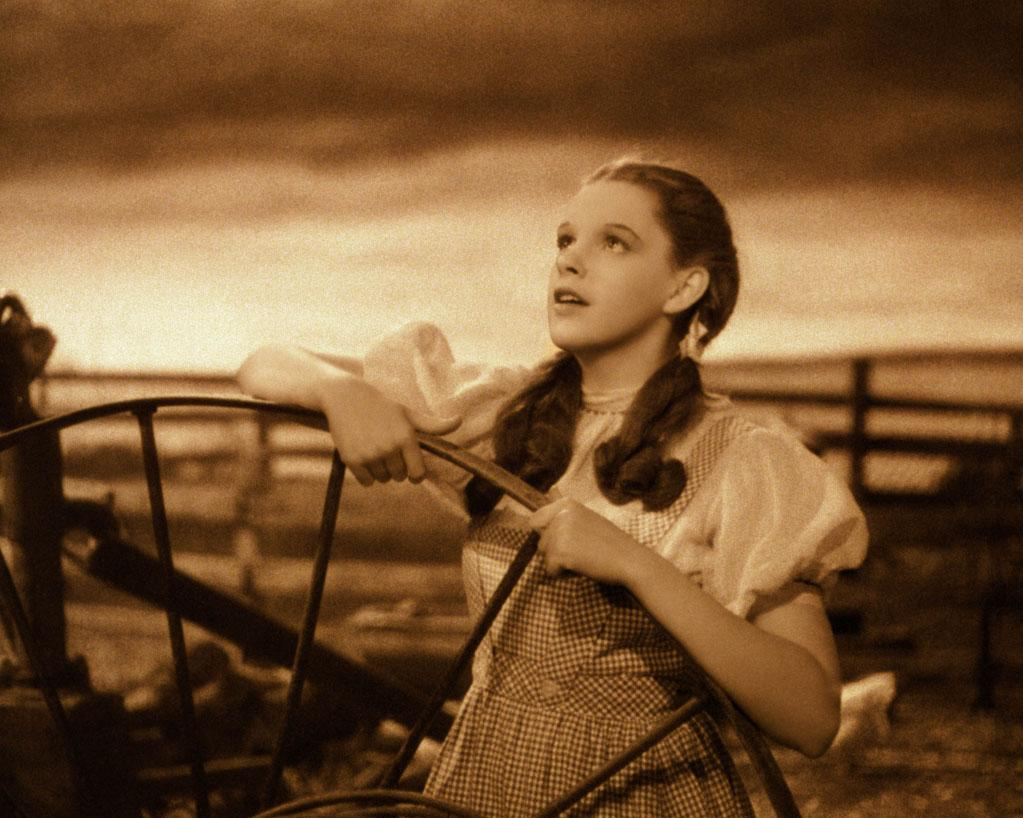 """Over the Rainbow"" from ""The Wizard of Oz"" (1939): One of the greatest songs ever from one of the greatest movies ever. A favorite from childhood that's just as moving for grown-ups, it's full of girlish innocence and melancholy longing. Written by Harold Arlen and E.Y. Harburg, it's been copied and covered endlessly by singers ranging from Frank Sinatra to Kylie Minogue. Sam Harris became a minor star by belting out a soaring version of it on ""Star Search"" in the mid-'80s, and Katharine McPhee made it one of her signature tunes on ""American Idol."" But of course it will always belong to Judy Garland. She performs it early in the film when she's still a naive farm girl, before all the tornadic activity and house-dropping that inspire her journey down the yellow brick road."