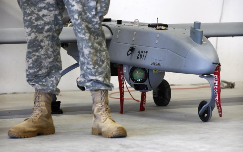 A soldier stands in front of a 'Shadow' drone during presentation by UAS at US military base in Vilseck-Grafenwoehr