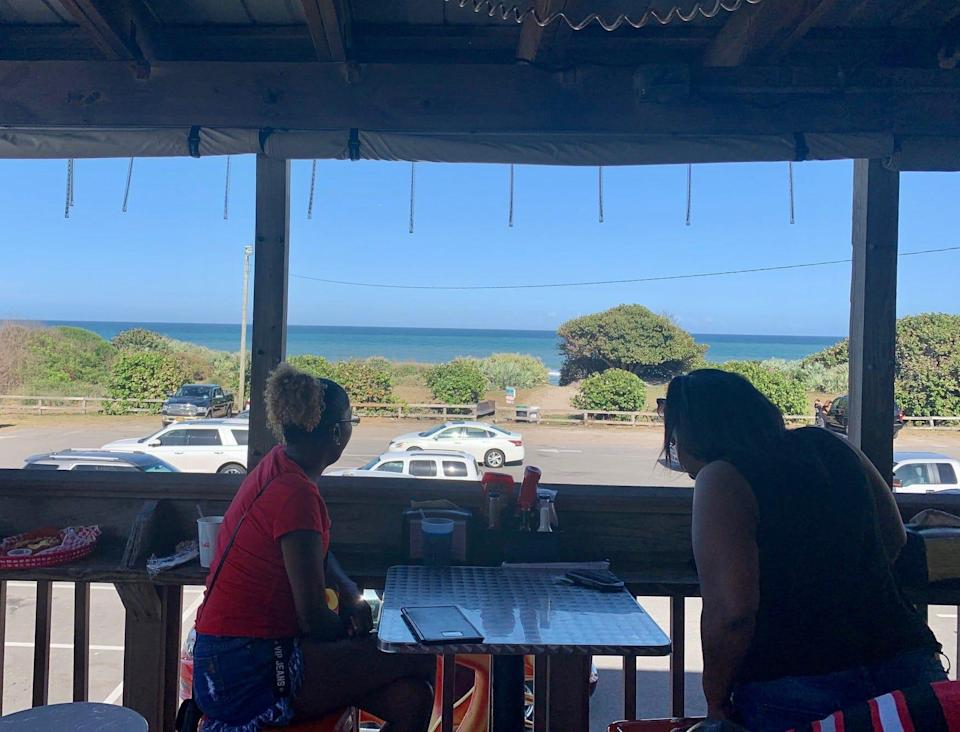 If you arrive at Lou's Blues Bar & Grill early enough, you can snag a coveted table by the railing overlooking the ocean.