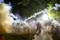 Tear gas rises above as protesters face off with police during a demonstration outside the White House