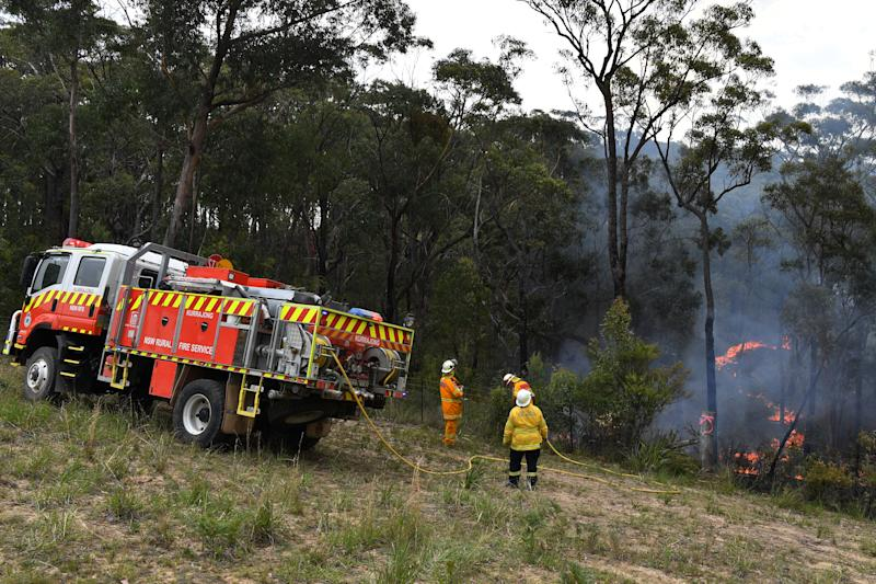 A photo of NSW firefighters at the Gospers Mountain fire earlier in the week.