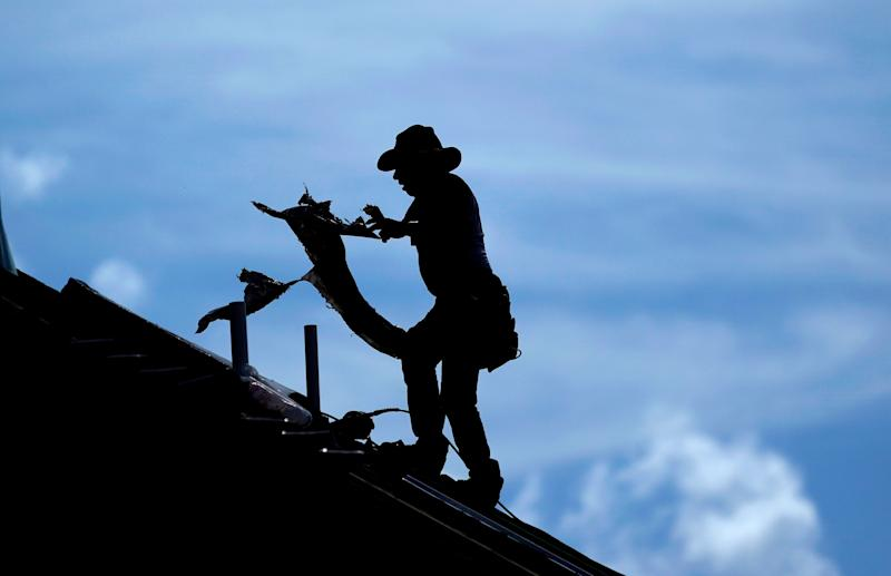 A roofer works on a home under construction in Houston Thursday. A heat wave is expected to send temperatures soaring close to 100 degrees through the weekend across much of the country. (Photo: ASSOCIATED PRESS)