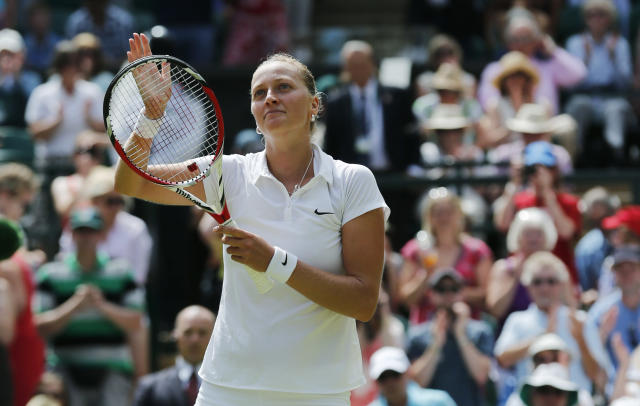 Petra Kvitova of Czech Republic waves to the crowd after she defeated Lucie Safarova of Czech Republic following their women's singles semifinal match at the All England Lawn Tennis Championships in Wimbledon, London, Thursday, July 3, 2014. (AP Photo/Ben Curtis)