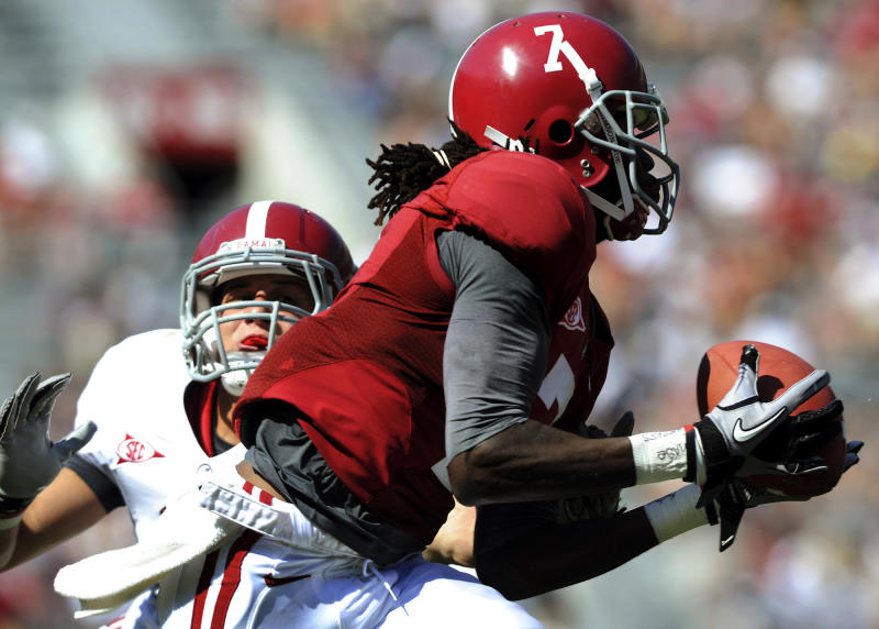 Alabama wide receiver Kenny Bell hauls in a 47-yard touchdown pass from quarterback AJ McCarron in front of defensive back Vinnie Sunseri to end the third quarter of the A-Day NCAA college football game in Tuscaloosa, Ala., Saturday, April 14, 2012. (AP Photo/The News, Mark Almond) MAGS OUT