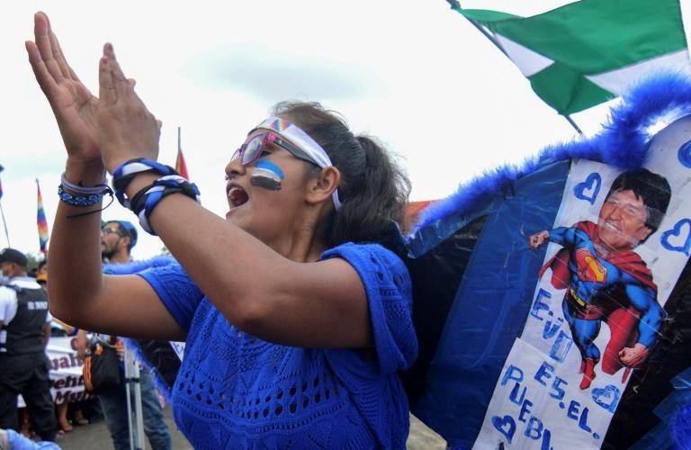 A supporter of Evo Morales applauds during his homecoming rally in Chimore, Bolivia on November 11, 2020