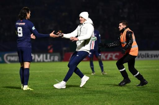 Fan club: A supporter runs towards Paris Saint-Germain's Edinson Cavani during the game at Bondoufle, south of Paris, on Sunday
