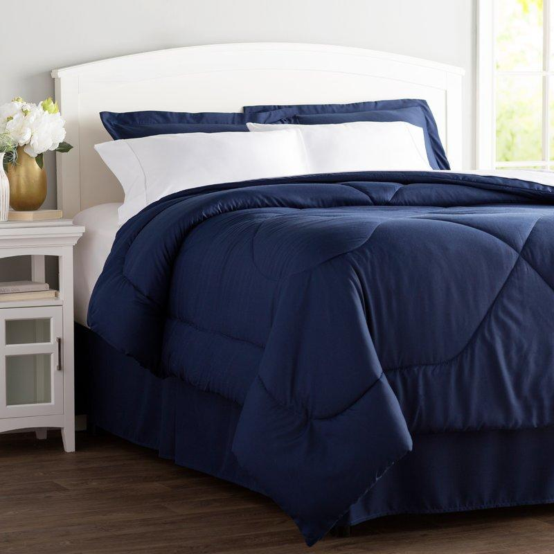"""<p><strong>Wayfair Basics\u2122</strong></p><p>wayfair.com</p><p><strong>$32.99</strong></p><p><a href=""""https://go.redirectingat.com?id=74968X1596630&url=https%3A%2F%2Fwww.wayfair.com%2Fbed-bath%2Fpdp%2Fwayfair-basics-wayfair-basics-8-piece-bed-in-a-bag-set-wfbs1884.html&sref=http%3A%2F%2Fwww.goodhousekeeping.com%2Fhome%2Fdecorating-ideas%2Fg27332121%2Fcollege-dorm-room-essentials%2F"""" target=""""_blank"""">Shop Now</a></p><p>You could splurge on a <a href=""""https://www.goodhousekeeping.com/home/a22738218/buffy-comforter-review/"""" target=""""_blank"""">cloud-soft comforter</a> and <a href=""""https://www.goodhousekeeping.com/home-products/best-sheets/a23319813/sheex-micro-balance-37-5-performance-sheet-review/"""" target=""""_blank"""">ultra-cooling sheets</a>, and we wouldn't blame you — after all, when you're in college, you need a good night's sleep where you can get it. But if you want an affordable way to get a comforter, fitted sheet, flat sheet, dust ruffle, and pillowcases, just grab Wayfair's bed-in-a-bag set, which comes in 10 colors.</p><p><strong>RELATED: <a href=""""https://www.goodhousekeeping.com/home-products/comforter-reviews/a25635913/best-bedding-sets/"""" target=""""_blank"""">The 5 Best Bedding Sets You Can Buy at Every Price</a></strong></p>"""