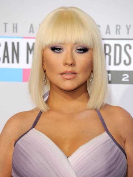 FILE - In this Nov. 18, 2012 file photo, Christina Aguilera arrives at the 40th Anniversary American Music Awards in Los Angeles. The Rock and Roll Hall of Fame and Museum announced Wednesday, Jan. 23, 2013, that Aguilera, John Mayer and Jennifer Hudson are among the stars set to perform at the 28th annual Rock and Roll Hall of Fame induction ceremony to be held on April 18, 2013, in Los Angeles. (Photo by Jordan Strauss/Invision/AP, File)