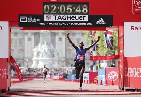 Kenya's Daniel Wanjiru celebrates winning the men's elite race