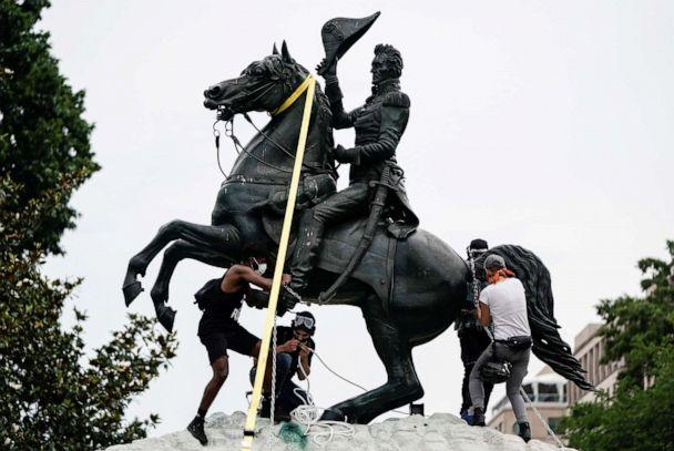 PHOTO: Protesters attempt to pull down the statue of President Andrew Jackson in the middle of Lafayette Park in front of the White House during racial inequality protests, June 22, 2020. (Joshua Roberts/Reuters)