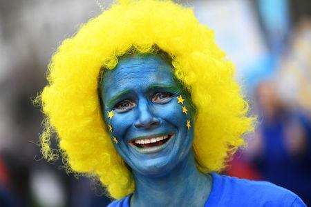 An EU supporter with her face painted, calling on the government to give Britons a vote on the final Brexit deal, participates in the 'People's Vote' march in central London, Britain March 23, 2019. REUTERS/Dylan Martinez