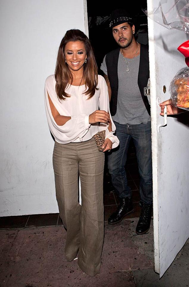 """A happy looking Eva Longoria spent her Sunday evening on a date with boyfriend Eduardo Cruz (Penelope's brother) at none other than her own restaurant, Beso in Hollywood. We're sure she got great service ... SPW/<a href=""""http://www.splashnewsonline.com"""" target=""""new"""">Splash News</a> - July 24, 2011"""