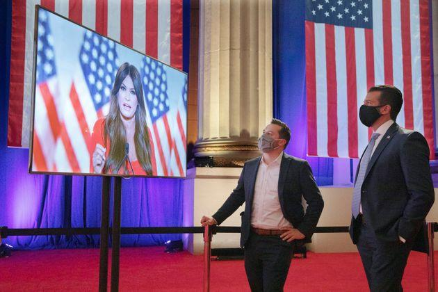 Donald Trump Jr. (right) watches his girlfriend, Kimberly Guilfoyle, a Trump campaign aide, as she records her address for Monday night's Republican National Convention program.