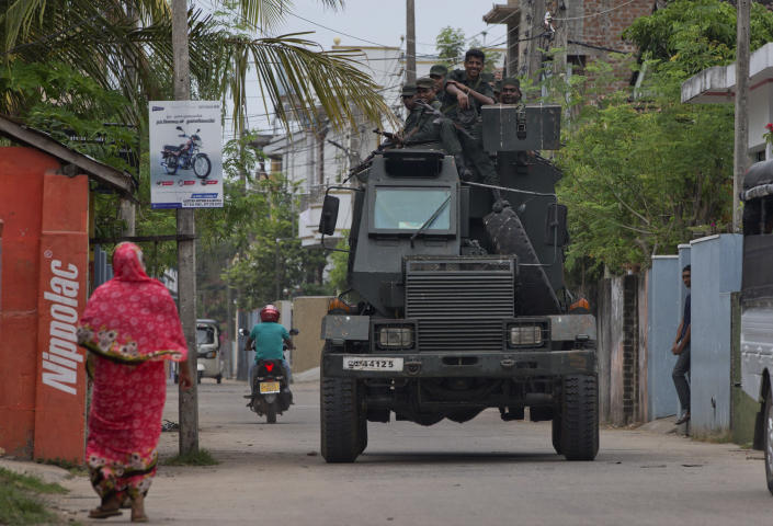 """Soldiers return to their base following an operation searching for explosives and suspects tied to a local group of Islamic State militants in Kalmunai, Sri Lanka, Monday, April 29, 2019. The Catholic Church in Sri Lanka on Monday has urged the government to crack down on Islamic extremists with more vigor """"as if on war footing"""" in the aftermath of the Easter bombings. (AP Photo/Gemunu Amarasinghe)"""