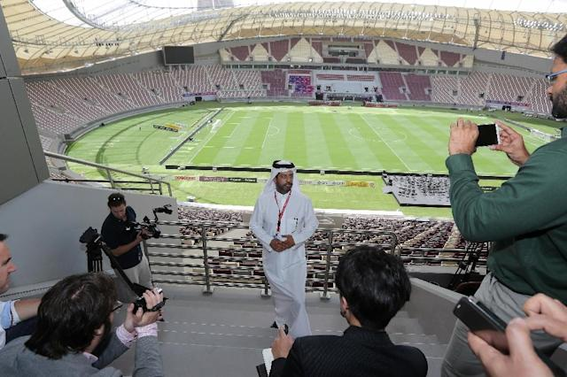 Nasser Al-Khater (C), a senior figure with the body organising Qatar's World Cup, speaks to journalists during a tour of the Khalifa International Stadium in Doha, on May 18, 2017 (AFP Photo/KARIM JAAFAR)