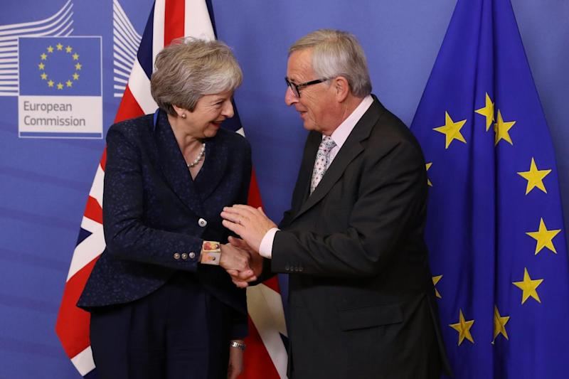 Jean-Claude Juncker, president of the European Commission, welcomes Theresa May to a meeting (Sean Gallup/Getty Images)