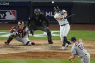 New York Yankees' Giancarlo Stanton follows through on a double during the fifth inning of a baseball game against the Houston Astros Tuesday, May 4, 2021, in New York. The Yankees won 7-3. (AP Photo/Frank Franklin II)
