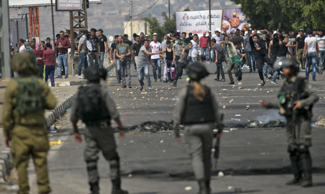 "<p>Palestinians clash with Israeli security forces after a protest marking Nakba, or ""catastrophe"", commemorating the more than 700,000 Palestinians who fled or were expelled in the 1948 war surrounding Israel's creation, and against the US' relocation of its embassy from Tel Aviv to Jerusalem, at the Hawara checkpoint south of Nablus on May 15, 2018. (Photo: Jaafar Ashtiyeh/ AFP/Getty Images) </p>"