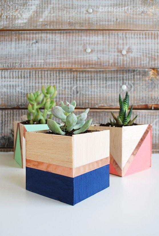 """<p>Color-blocked balsa wood — yep, those blocks of wood you see at your nearby craft store — feels modern and cool with the help of mini succulents. <br></p><p><em><a href=""""http://www.brepurposed.com/2015/04/01/diy-balsa-wood-planters/"""" rel=""""nofollow noopener"""" target=""""_blank"""" data-ylk=""""slk:Get the tutorial at Bre Purposed »"""" class=""""link rapid-noclick-resp"""">Get the tutorial at Bre Purposed »</a></em> </p>"""