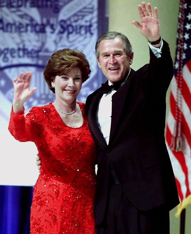 President Bush and his wife Laura Bush wave to the crowd after sharing a dance at the Ohio Inaugural Ball in Washington, D.C. on Saturday, Jan. 20, 2001. (AP Photo/Amy Sancetta)