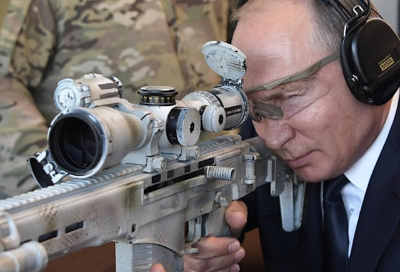 Vladimir Putin was visiting a military-themed park called Patriot when he showed off his sniper skills (AFP Photo/Alexey NIKOLSKY)