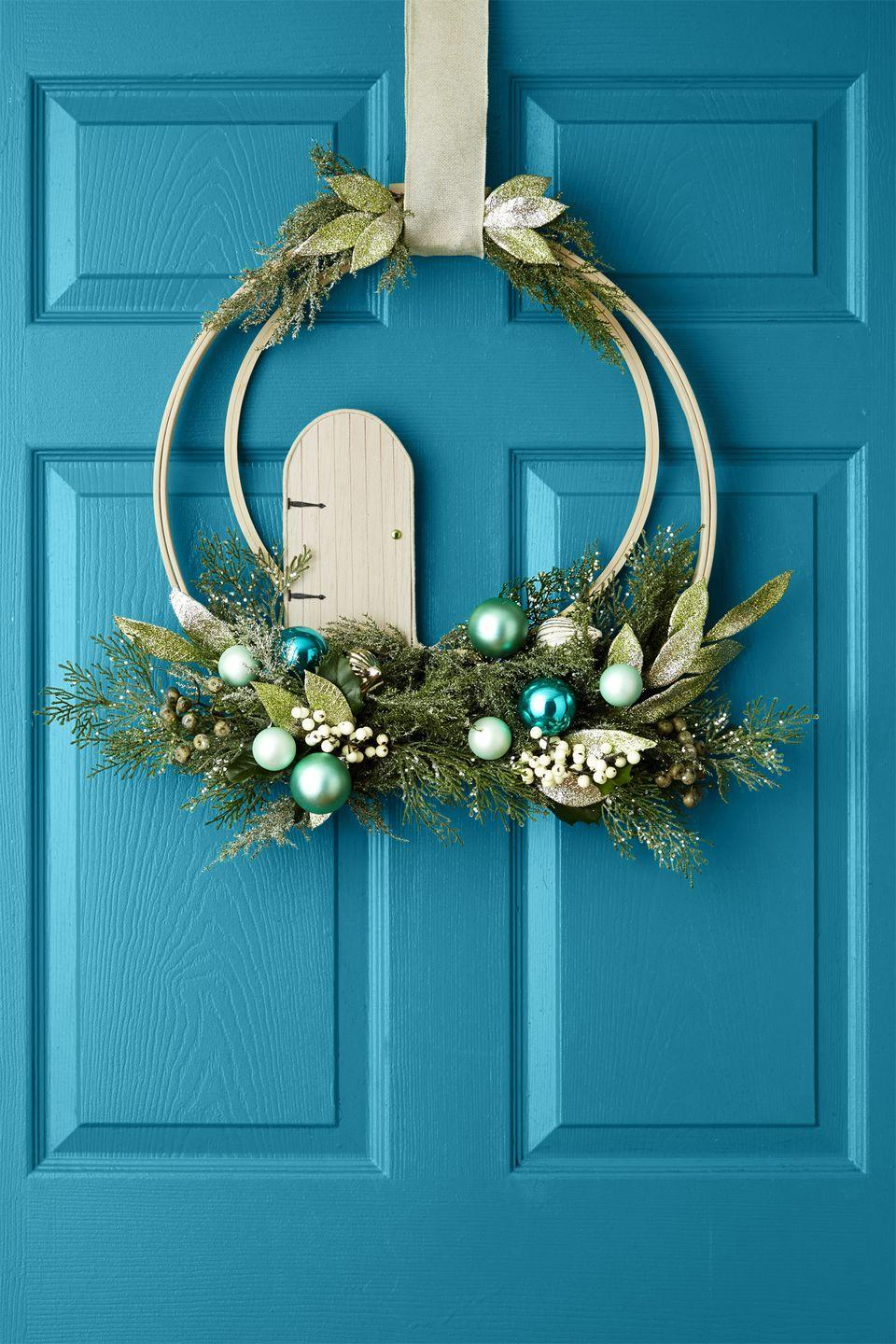 "<p>Santa's elves will feel a warm (and not to mention, magical) welcome with this fairy-approved wreath. Add a tiny fairy door to a decked-out embroidery hoop for a unique fix. </p><p><a class=""link rapid-noclick-resp"" href=""https://www.amazon.com/Touch-Nature-Garden-Wooden-4-Inch/dp/B00DDVDPDW/?tag=syn-yahoo-20&ascsubtag=%5Bartid%7C10055.g.2361%5Bsrc%7Cyahoo-us"" rel=""nofollow noopener"" target=""_blank"" data-ylk=""slk:SHOP FAIRY DOORS"">SHOP FAIRY DOORS</a> </p>"