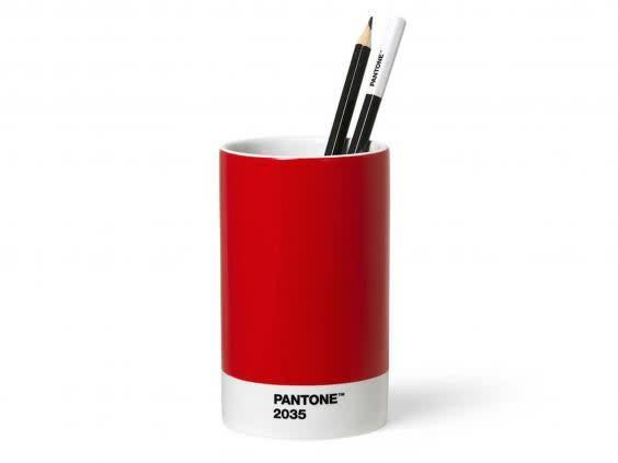 Introduce some colour into your workspace with stationary pieces such as this pen pot (Dot Maison)