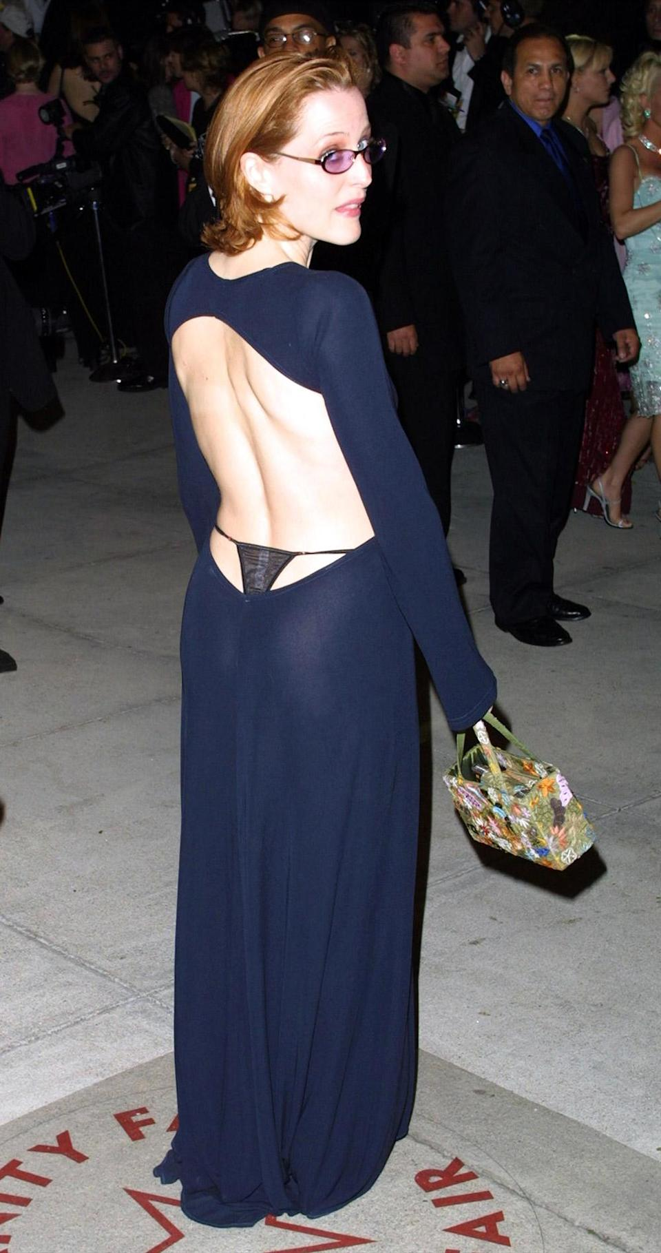 <p>If 'Daring Fashion Moves' was the name of the game, Gillian Anderson came to compete. She wore a backless dress to the Vanity Fair post-Oscar party, and used her underwear as an accessory. </p>