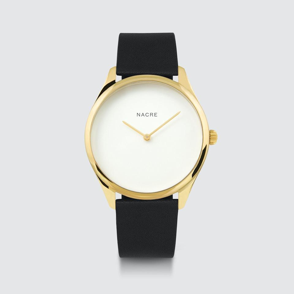 """For a minimalist watch that defines timeless, check out Nacre. The brother and sister-founded brand designs beautiful no-frills pieces in addition to offering a <a href=""""https://cna.st/affiliate-link/8WDqjKE1n2iBUH4736AGfhN16vrQnPPqaXqGeGLAhn2o2TR9NDgp61jeTzkFTB8oP3HWWJeRbV6rh2q1iARoqs3tmj6unD9vpSJyrg2ptYUf?cid=607f0365586c607b8a94d567"""" rel=""""nofollow noopener"""" target=""""_blank"""" data-ylk=""""slk:build-your-own watch"""" class=""""link rapid-noclick-resp"""">build-your-own watch</a> feature. $170, Verishop. <a href=""""https://www.verishop.com/nacre/marketplace/lune-gold-black-leather/p6119851262146?variant_id=37748721549506"""" rel=""""nofollow noopener"""" target=""""_blank"""" data-ylk=""""slk:Get it now!"""" class=""""link rapid-noclick-resp"""">Get it now!</a>"""