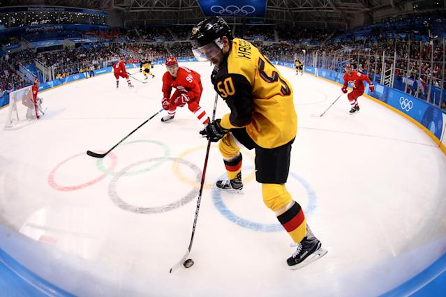 <p>Patrick Hager #50 of Germany controls the puck in the second period against Alexander Barabanov #94 of Olympic Athletes from Russia during the Men's Gold Medal Game on day sixteen of the PyeongChang 2018 Winter Olympic Games at Gangneung Hockey Centre on February 25, 2018 in Gangneung, South Korea. (Photo by Jamie Squire/Getty Images) </p>