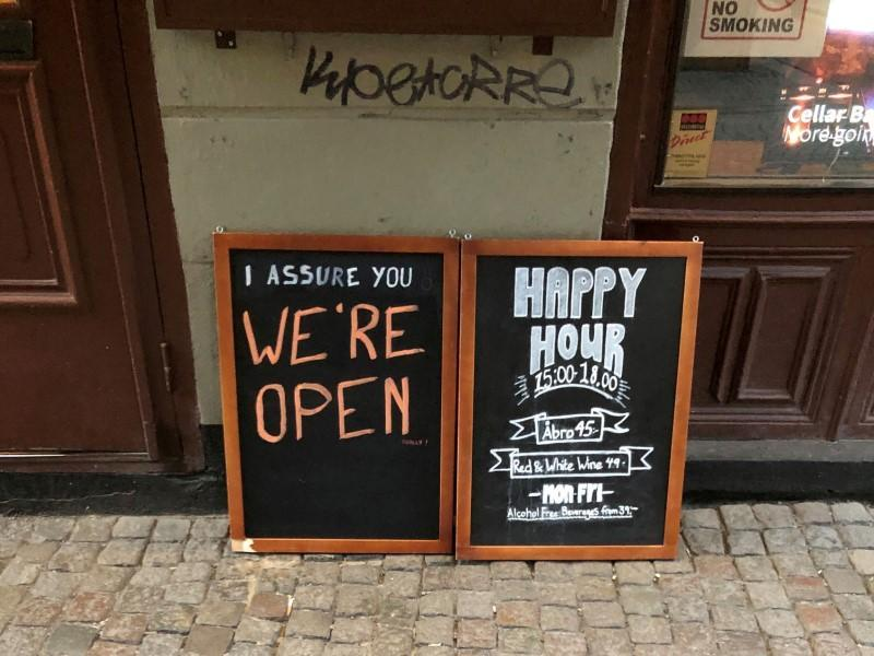 FILE PHOTO: Sign assures people that a bar is open during the coronavirus outbreak in Stockholm