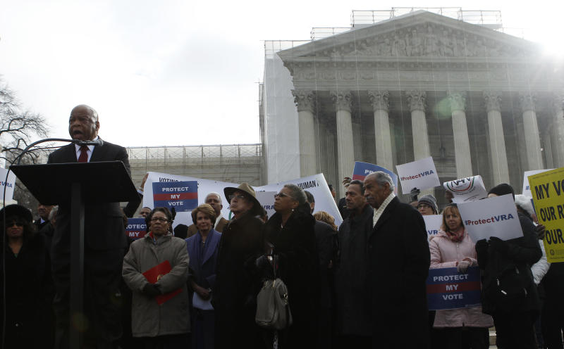 Rep. John Lewis (D-Ga.) speaks at a rally before the five conservatives on the Supreme Court struck down Section 5 of the Voting Rights Act in the Shelby County v. Holder case. (Gary Cameron / Reuters)