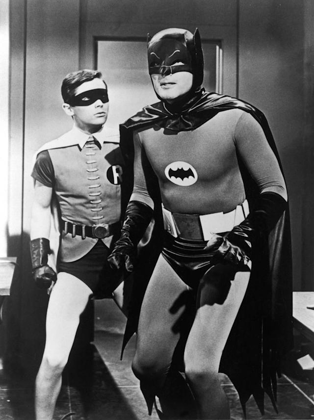 "<p>Burt Ward, left, and Adam West pause in a still from the television series ""Batman,"" circa 1967. (Photo: 20th Century Fox/Getty Images) </p>"