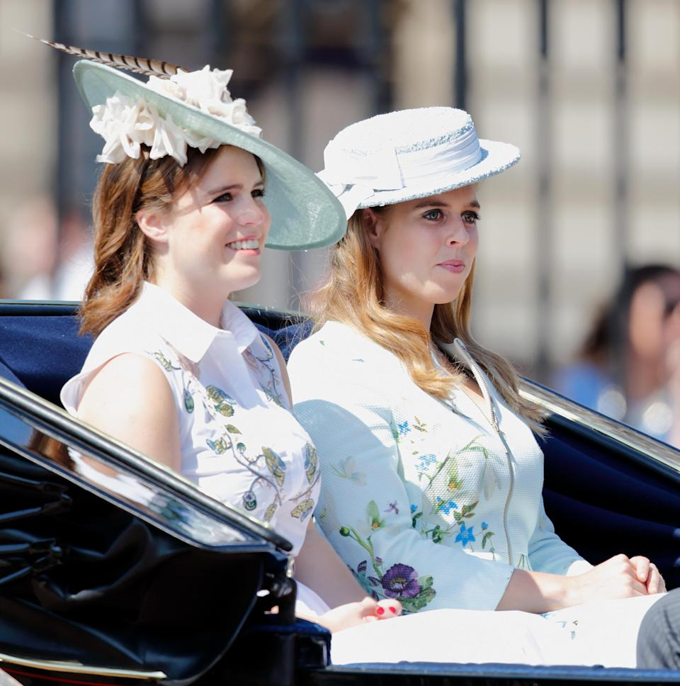 For last year's event, sisters Beatrice and Eugenie donned co-ordinating floral looks accessorised with Philip Treacy hats. (Getty Images)