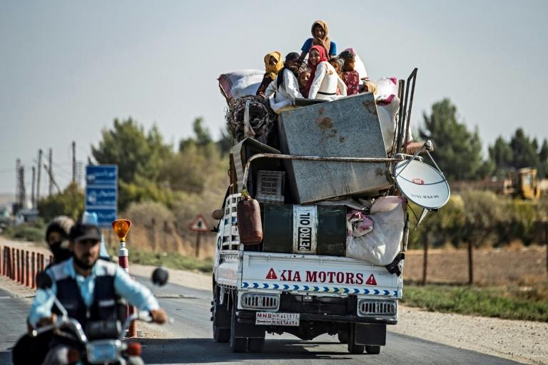 Civilians fleeing Turkey's invasion of the Kurdish-held northeast are taking with them all of the belongings they can, unsure when, if ever, they will be able to return once their homes come under the control of Ankara's Syrian Arab proxies (AFP Photo/Delil SOULEIMAN)