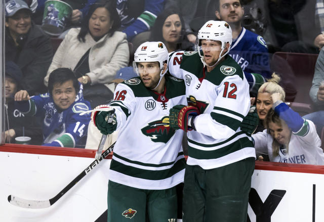 Minnesota Wild's Jason Zucker, left, and Eric Staal celebrate Zucker's second goal against the Vancouver Canucks during the second period of an NHL hockey game, Tuesday, Dec. 4, 2018, in Vancouver, British Columbia. (Darryl Dyck/The Canadian Press via AP)