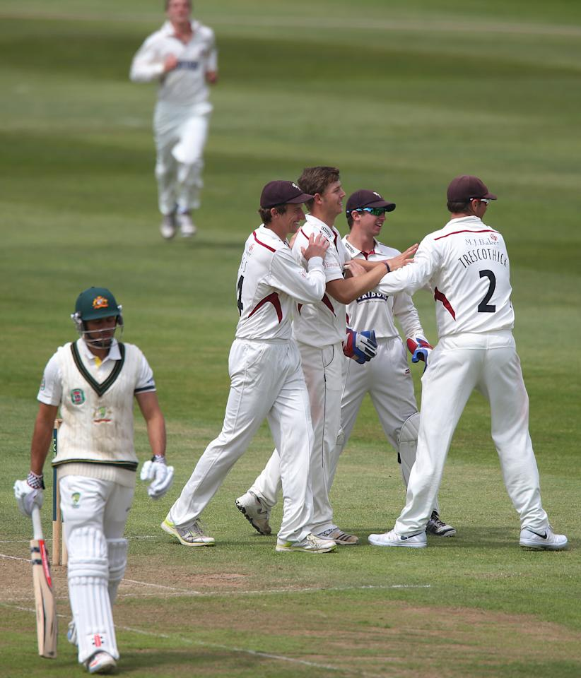 Somerset's Craig Meschede celebrates taking wicket of Australia batsman Usman Khawaja during the International Tour match at the County Ground, Taunton.