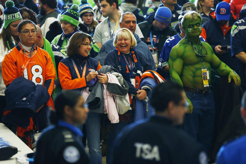 Football fans wait to go through security at the Secaucus Junction, Sunday, Feb. 2, 2014, in Secaucus, N.J. The Seattle Seahawks are scheduled to play the Denver Broncos in the NFL Super Bowl XLVIII football game on Sunday at MetLife Stadium in East Rutherford, N.J. (AP Photo/Matt Rourke)
