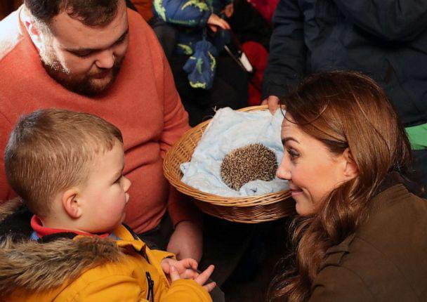 PHOTO: Britain's Catherine, Duchess of Cambridge reacts as she and a child look at a hedgehog during her visit to Ark Open Farm near Belfast on Feb. 12, 2020. (Liam Mcburney/AFP via Getty Images)
