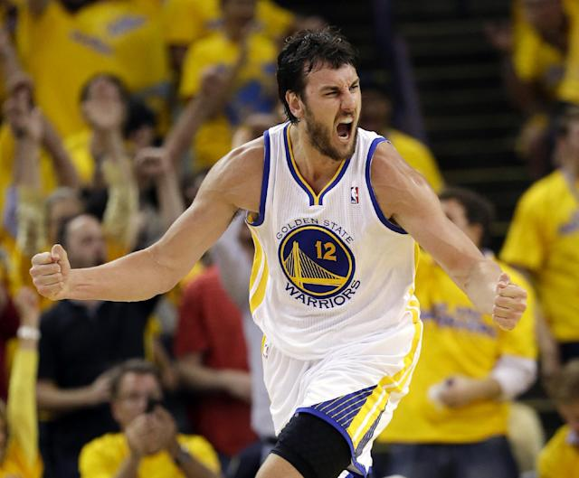 """FILE - In this May 2, 2013 file photo, Golden State Warriors' Andrew Bogut celebrates scoring against the Denver Nuggets during an NBA basketball game in Oakland, Calif. Bogut says he is """"100 percent"""" healthy and feeling the best he has since fracturing his left ankle in January 2012. (AP Photo/Marcio Jose Sanchez, File)"""