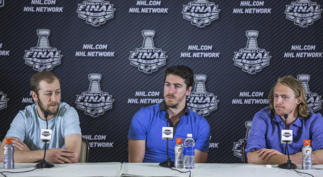 New York Rangers players from left, Derek Stepan, Ryan McDonagh and Carl Hagelin take questions from the media at a news conference in Santa Monica, Calif., Thursday, June 5, 2014. Rangers coach Alain Vigneault, not seen, challenged all his players to bring their A game to Game 2 of the Stanley Cup final. Not everyone did in the 3-2 loss Wednesday, against the Los Angeles Kings he suggested. (AP Photo/Damian Dovarganes)
